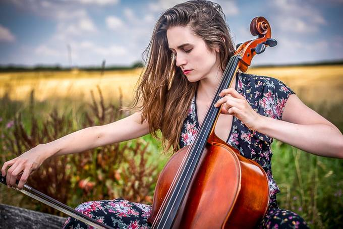 The cellist on a bench by EmC_Photography - Music And Concerts Photo Contest