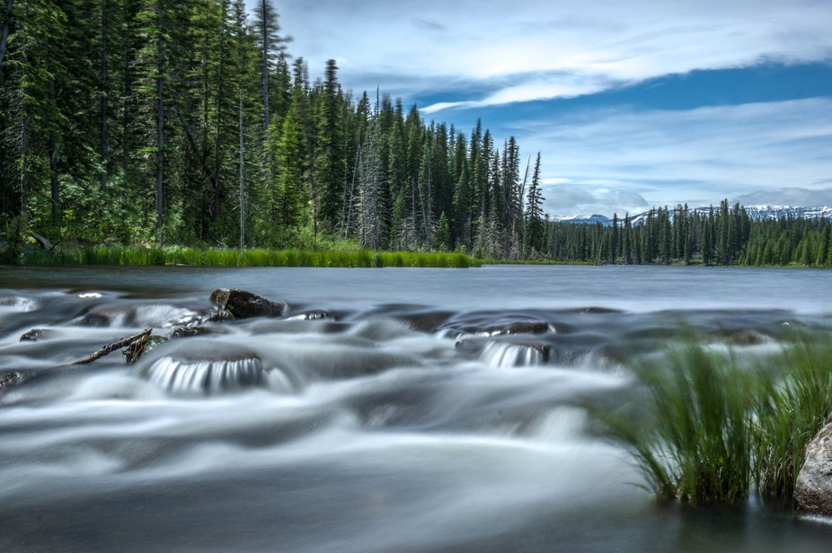 This beautiful lake is just east of Nordegg, Alberta and flows into a stream with a series of rap...