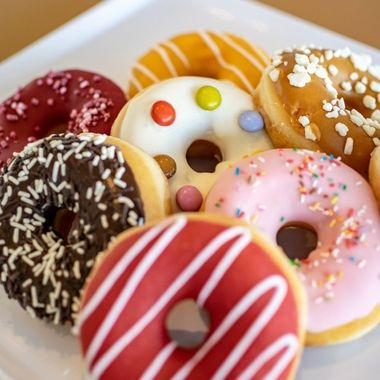 a collection of fruity doughnuts on a tray