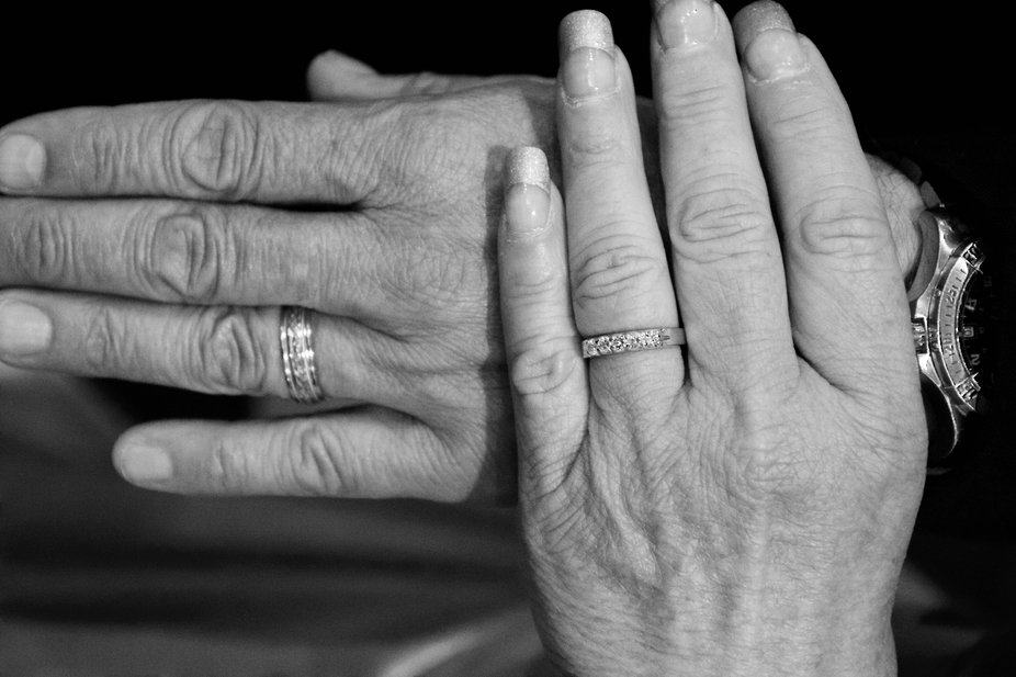 Hands of Bride and Groom on their wedding day.