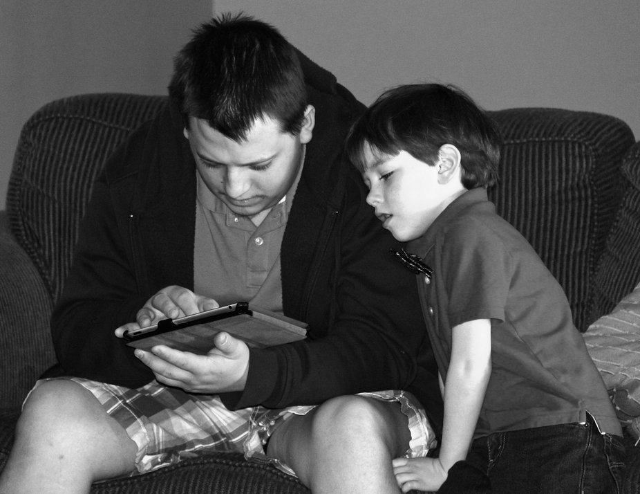 These are my two nephews and angry birds is the little ones favorite app but sometimes he needs help.