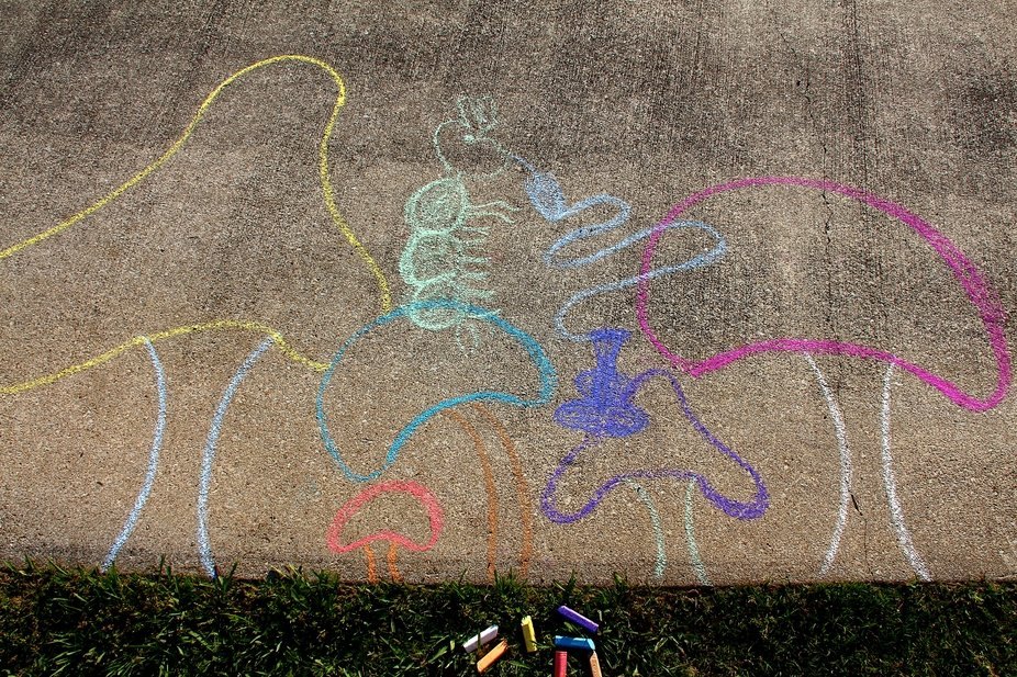 Nothing say summer, like decorating your driveway with stories, race tracks, and doodles.