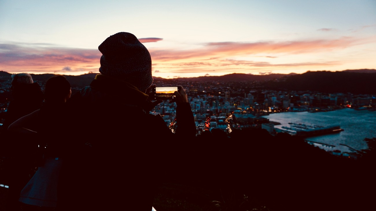 On the top of Mt Victoria, Wellington, a tourist captures an image