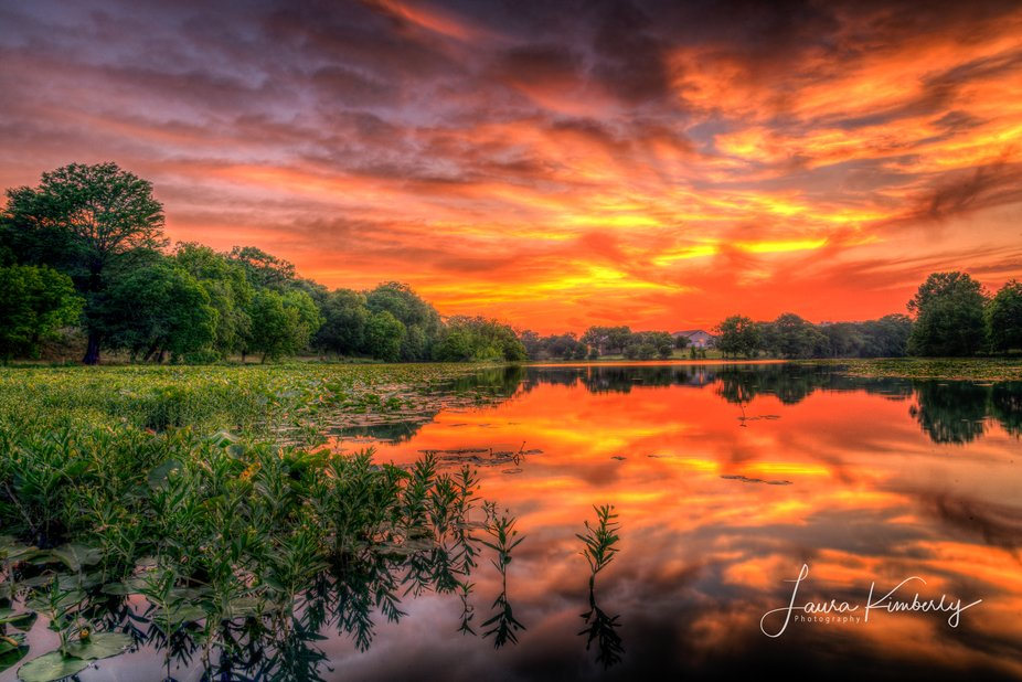 Sunset reflected off the water at Indian Creek off Old Ingram Loop in Ingram Texas.