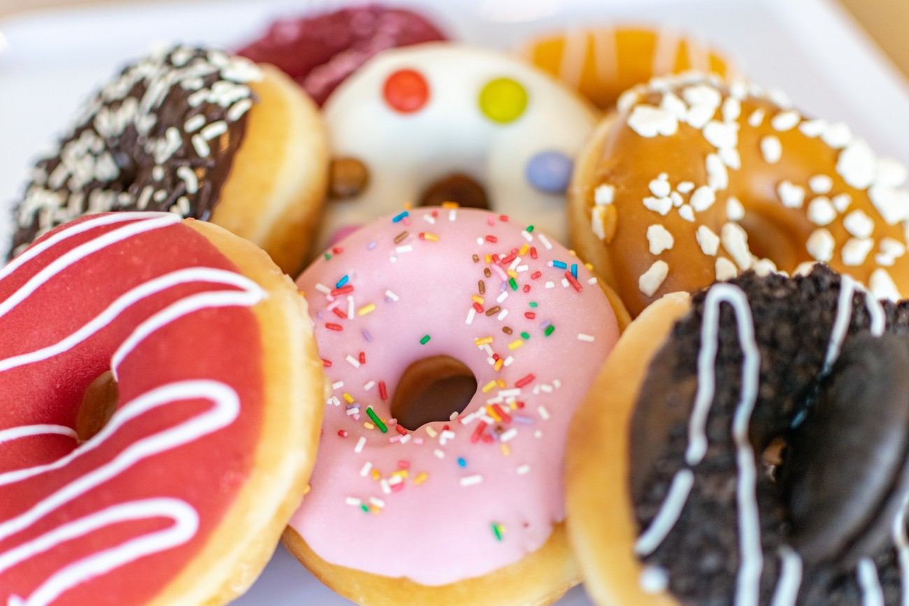 a collection of sweet and sticky colourful donuts