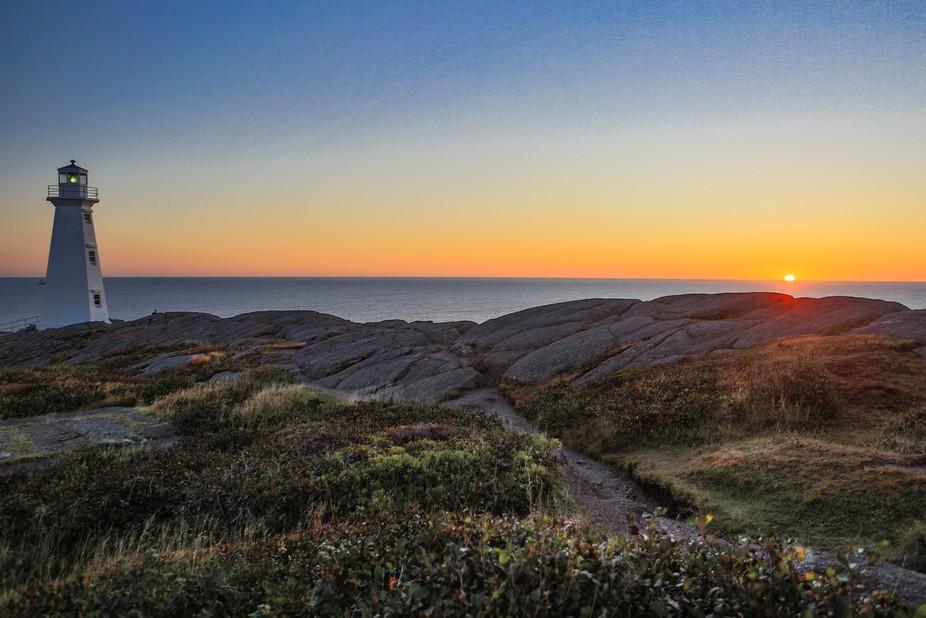 Sun rises over the Atlantic Ocean at Cape Spear Newfoundland.