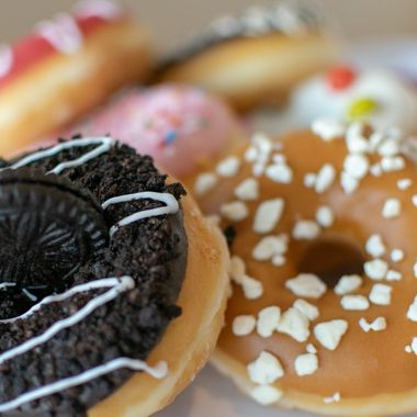 a close up shot of a selection of sweet donuts
