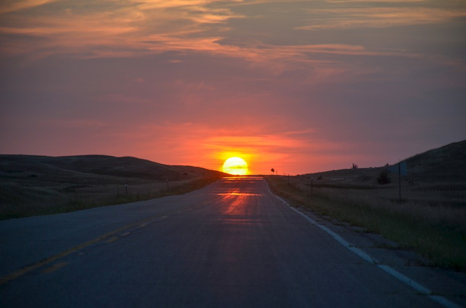The sunset along highway 1806 in South Dakota, I was trying to catch it