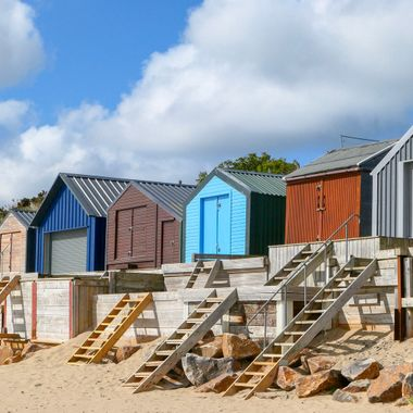 Beach huts on Abersoch beach, Wales.