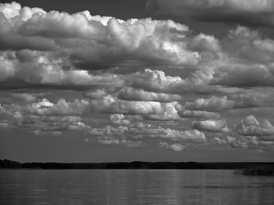 Partly cloudy over the Vuoksa river. Black-and-white photograph.