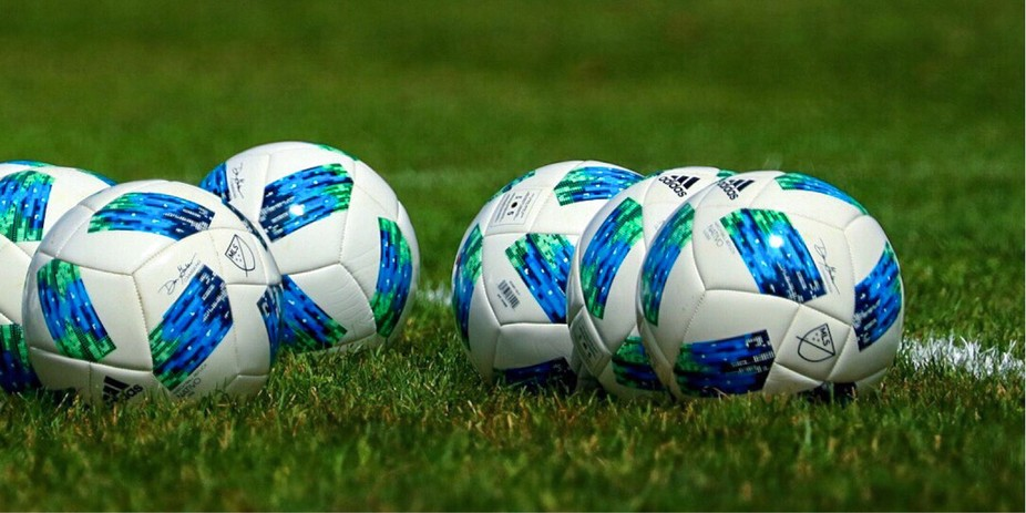 There were several more soccer balls on the field