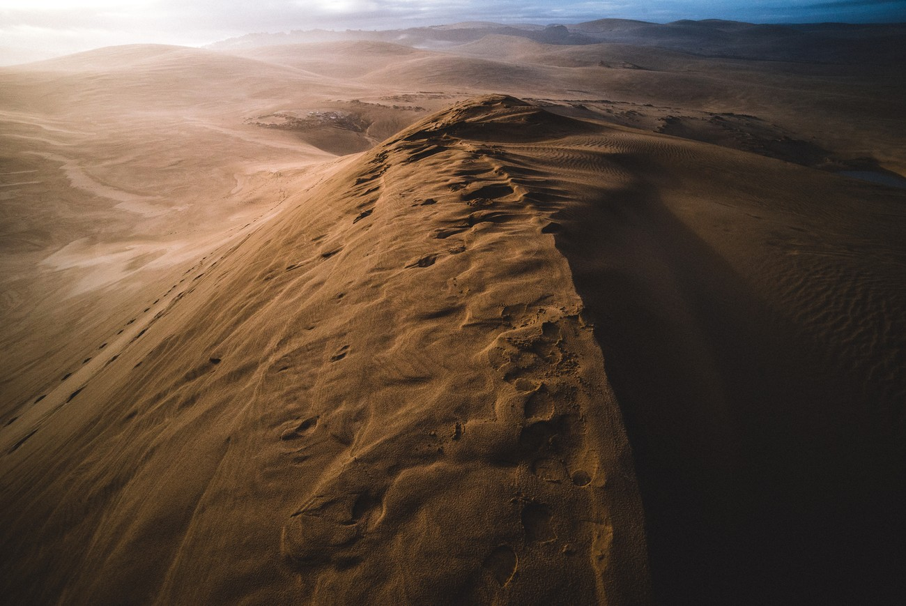 New Zealand's giant sand dunes really look like Mars early in the morining as the sun is red. Ocean is not far but invisible in the middle of the 150m high mounts.