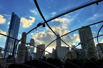 #chicago there's some stuff I don't like about you, but you sure are #pretty. #movies in #milleniumpark last #summer #park #city #illinois #midwest #buildings #skyscraper #skyline #architecture #dusk #clouds #sky #skyporn #line #form #light #sha