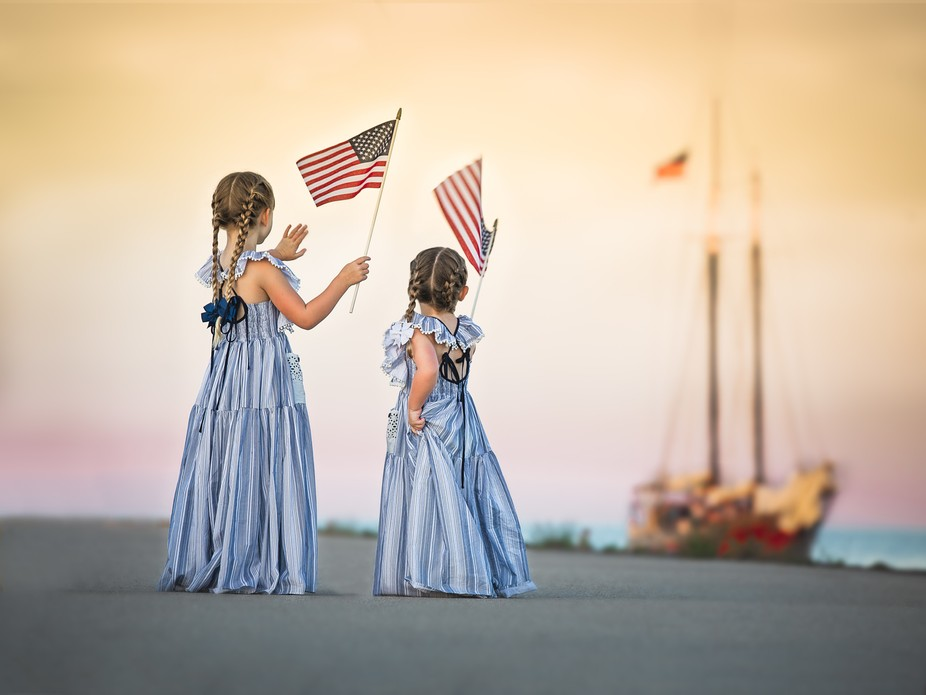 I took this image of my daughters as a boat passed by on a dock in Wisconsin over our 4th of July...