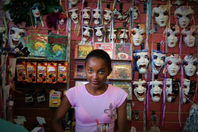 I was in her shop and snapped this photo.  Having done theater for many years, the masks intrigued me.  Wish I'd got her face more in focus.
