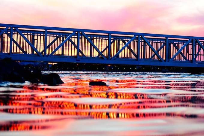 Voyaguers Nat'l Park Headquarters dock bridge at sunset. Love how the colors changed and the effect of the bridge on the water.