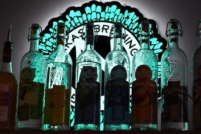Neon beer sign with bottles