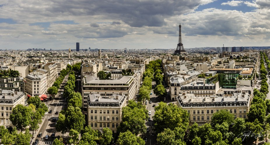 High above street level, the observation level of the Arc de Triomphe provides a serene view of P...