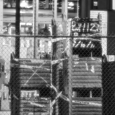 black and white shipping bins shot from the street