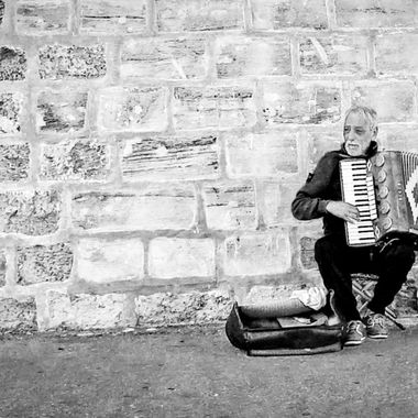 Share your best photo of a lone Street Musician