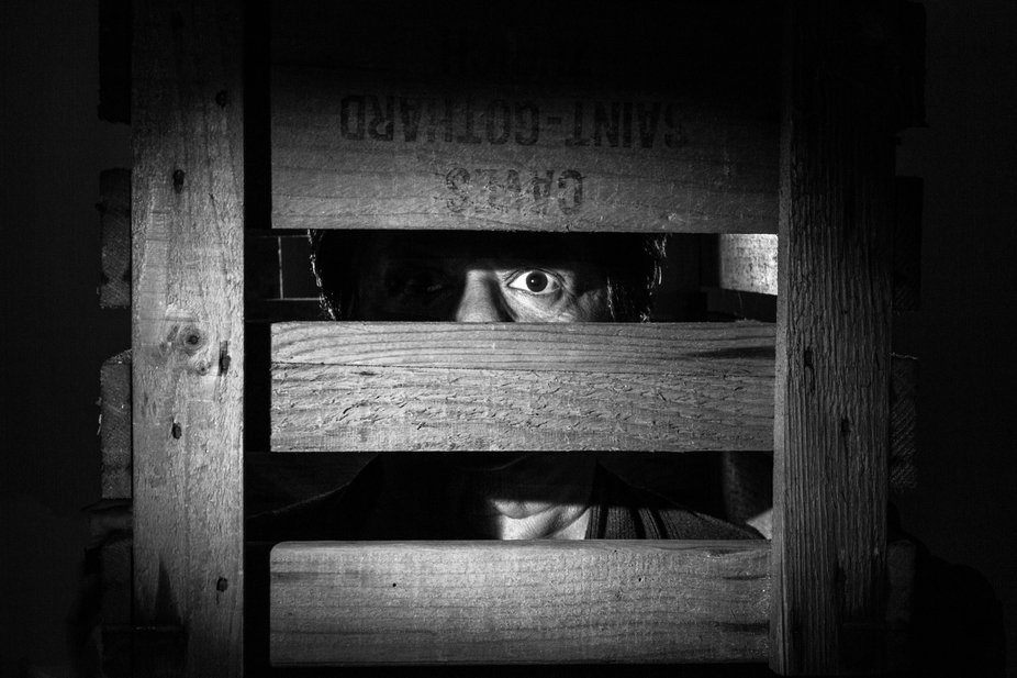 It shows a person boxed in by fear. It is telling a story about fear and how it is keeping us box...