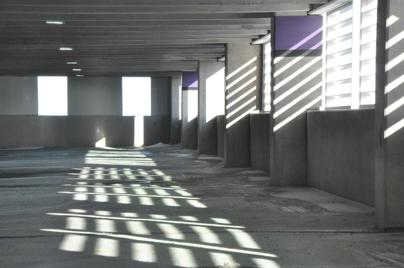 This is inside a parking structure which uses shutters.The light projected through the shutters was cold winter light creating the pattern seen in this photo