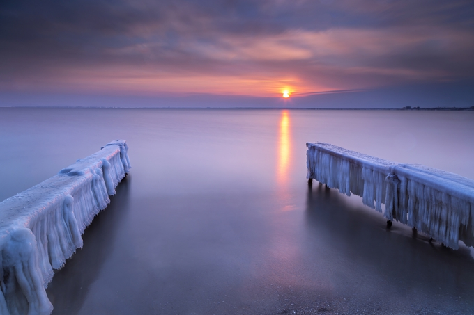 Pier covered with ice in winter by nikispasov - Image Of The Month Photo Contest Vol 37
