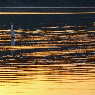 Two buoys in the Saint John River at sunrise.