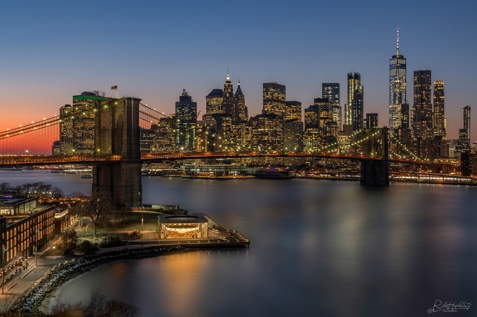 View of Brooklyn Bridge and New York Skyline by ritaholdhus - Bright City Lights Photo Contest