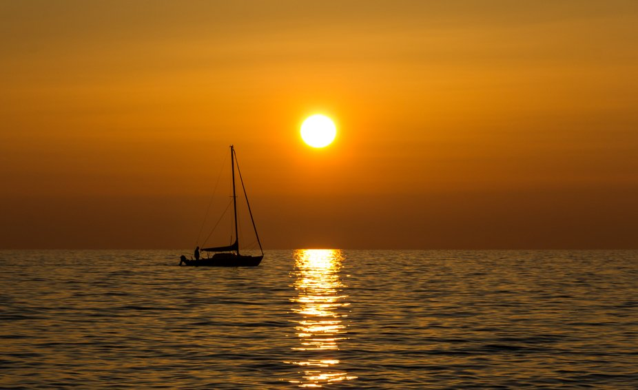 The sunset and the sailboat