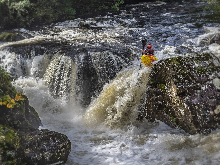 A very experienced Kayak paddler shoots the waterfall at Pont y Pair, Betws y Coed. North Wales.