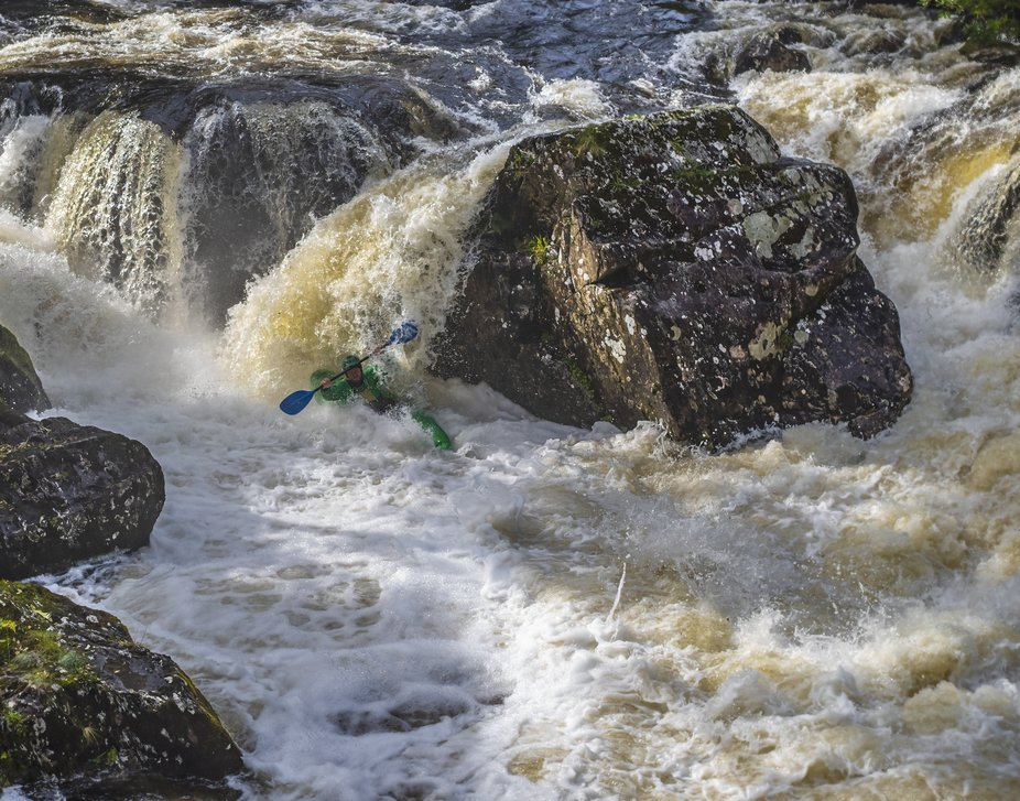 A very experienced Kayak paddler after shooting the waterfall at Pont y Pair, Betws y Coed. North...