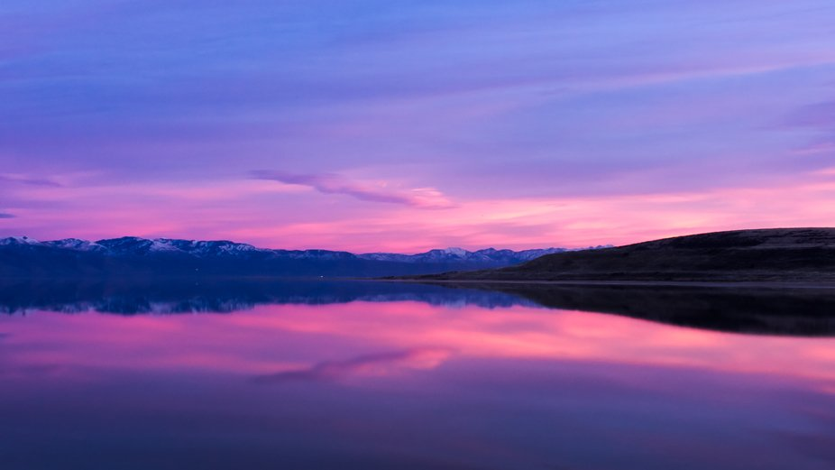 Taken at Antelope Island at the Great Salt Lake, Utah with pink skies and reflections off the water