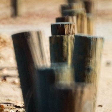 A line of wooden posts in the ground made for a nice blurred out photo.  Going through some older photos that I haven't gotten to do much of anything with as far as post-processing, now adding here to share.