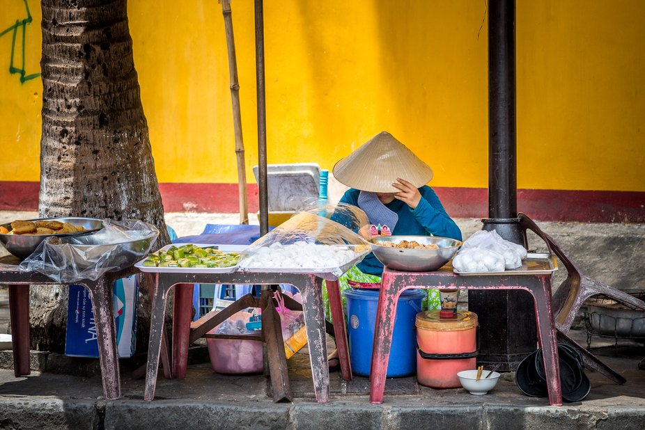 Always ready to prepare delicious street food this anonymous  Vietnames lady is killing time by l...