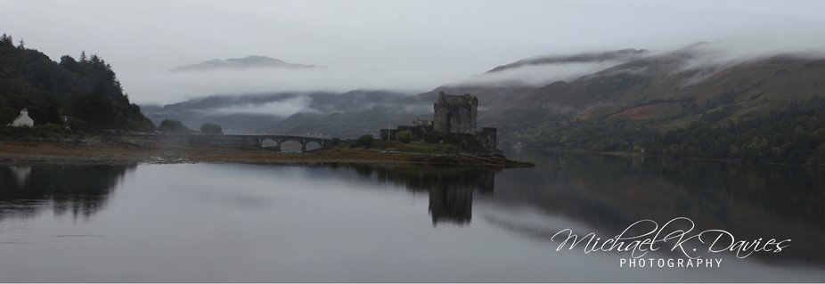 An early morning panoramic shot of Eilean Donan Castle on Loch Duich, Dornie, Higlands, Scotland,...