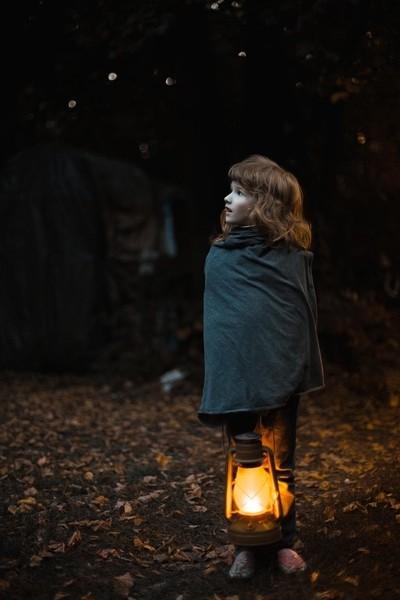 Little girl with kerosene lamp