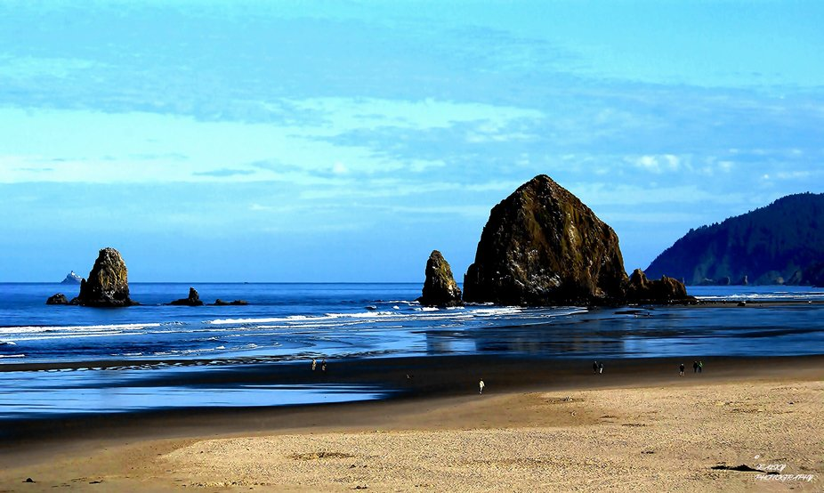 Looking north, morning at the beach at a low tide with Haystack Rock and the Needles in the dista...