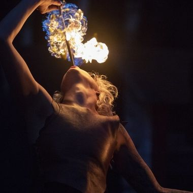 "The show group ""Trix"" shows there skills with fire breathing."