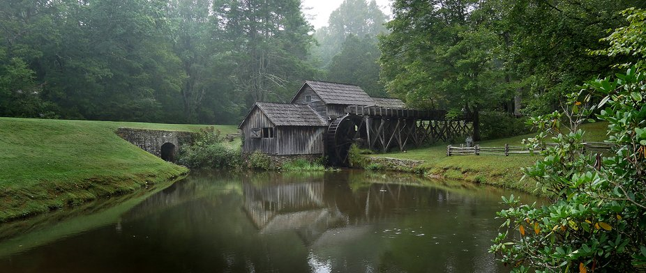 Mabry Mill on the Blue Ridge Parkway located at Meadow of the Dan, Virginia. A gloomy foggy day b...