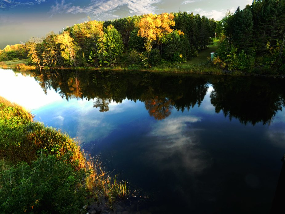 This picture is of the Bonnechere River showing off the clouds and trees in the mirror-like water...