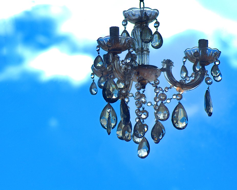 Chandelier against patchy sky