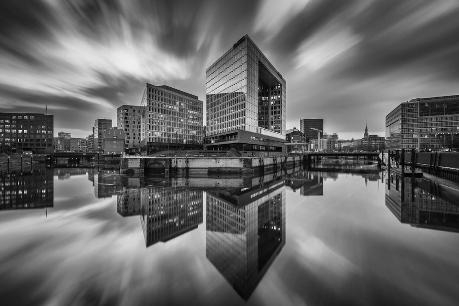 Long exposure shot of the Spiegelbuilding and surrounding Skyline in Hamburg.