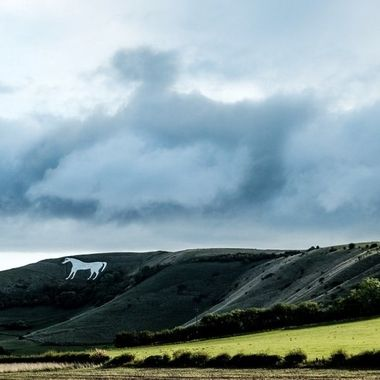 Accentuated the shape of a horse in the clouds above Westbury White Horse,UK.