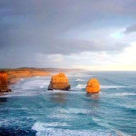 As the sunsets the rock stacks and cliffs change to a beautiful glowing rich red colour, an amazing sight! Great Ocean Road, Victoria, Australia.