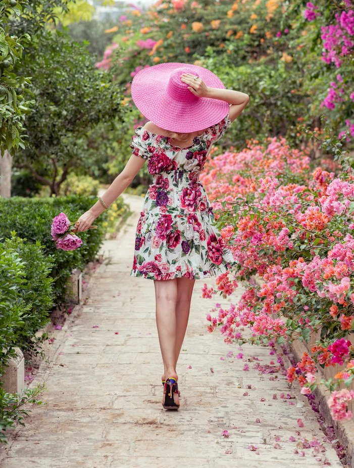 Fashion model walking and posing in a colourful garden on a Sunday Lunch by justinciappara - Pink Photo Contest