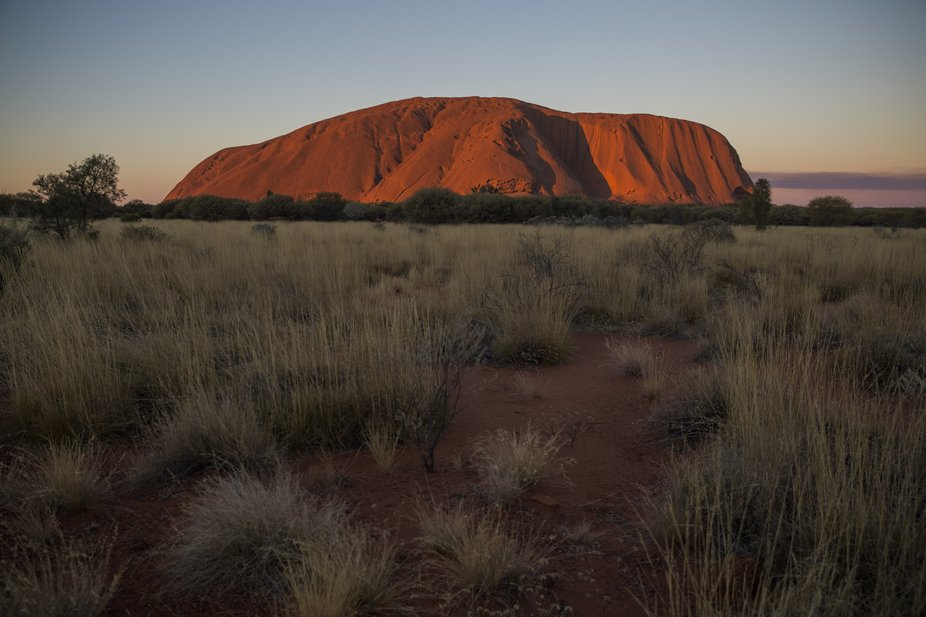 Sunset stood on the side of the road looking at Uluru, Ayers Rock