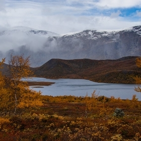 This photo taken at Jotunheimen in Norway shows the explosive colours of autumn at its finest, while contrasting to the white snow slowly buildin...