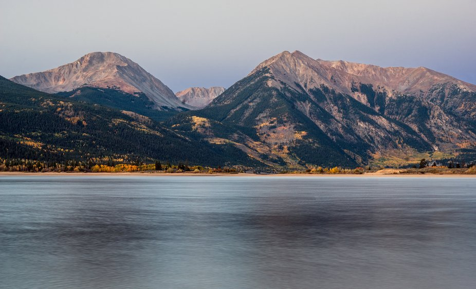 Mt. Hope and Rinker Peak rising above Twin Lakes, Colorado in the pre-dawn light on a cool autumn...