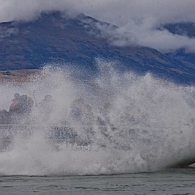 New Zealand, Dart River. Jet boat riders doing a 360.